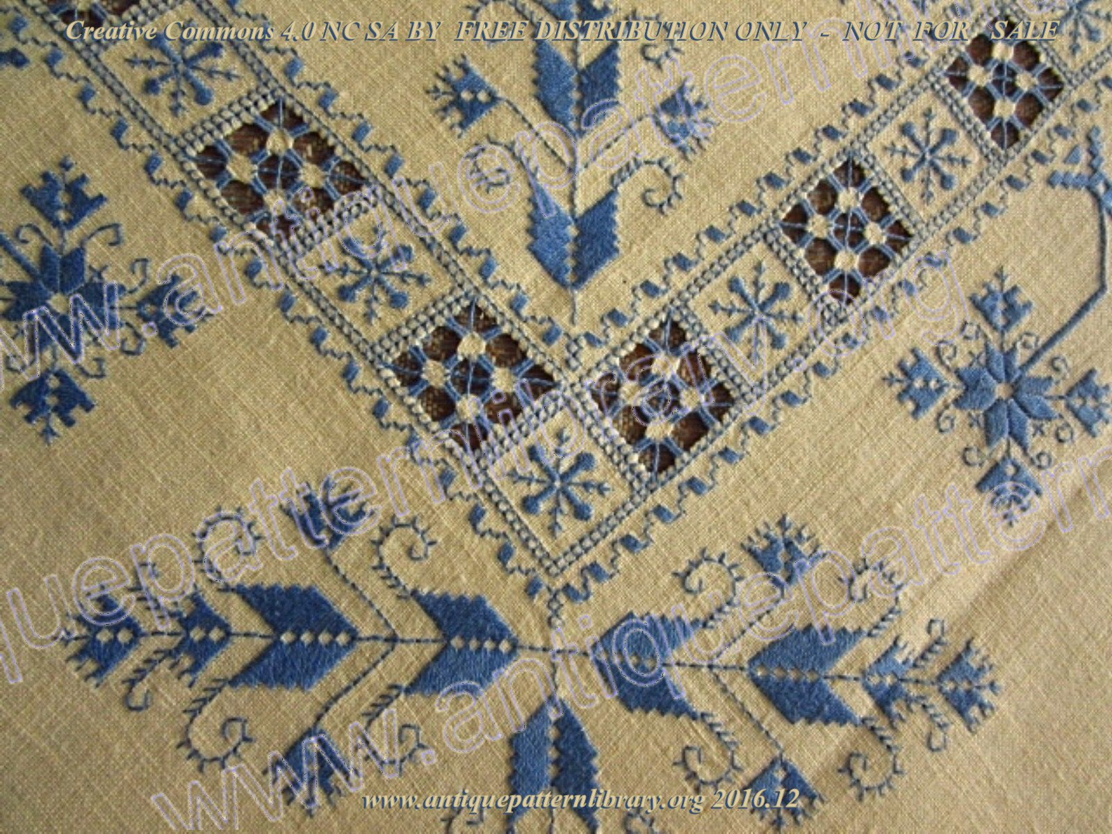 F-LU001 Table linen embroidered in blue with punto antico